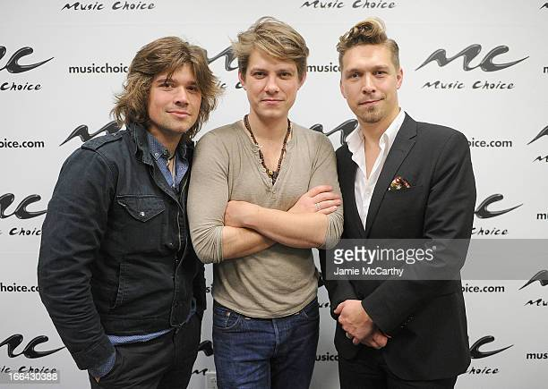 Zac Hanson Taylor Hanson and Isaac Hanson of the band Hanson visit 'UA' at Music Choice on April 12 2013 in New York City