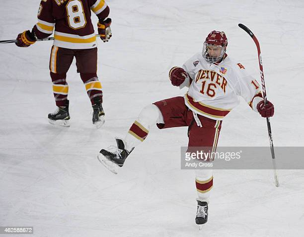 Zac Larraza of the Denver University Pioneers celebrates his first period goal against the University of Minnesota Duluth Bulldogs in the first...