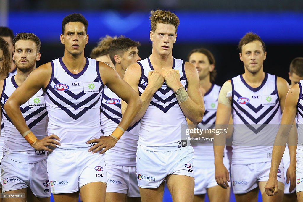 Zac Michael Johnson of the Dockers and Matt Taberner lead the team off after defeat during the Round 4 AFL match between North Melbourne v Fremantle...
