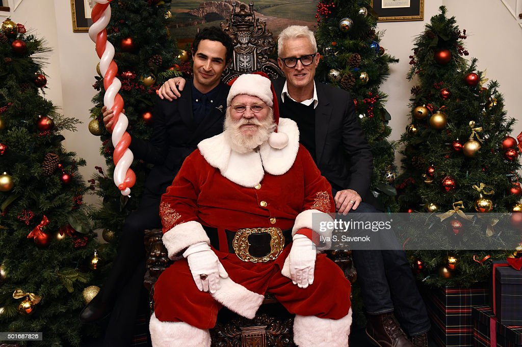 Zac Posen and John Slattery pose with Santa at Brooks Brothers holiday celebration with St Jude Children's Research Hospital Brooks Brothers Madison...