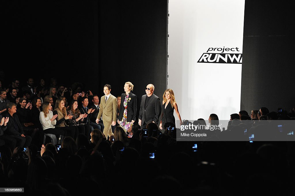Zac Posen, Heidi Klum, Michael Kors and Nina Garcia walk the runway at the Project Runway Fall 2013 fashion show during Mercedes-Benz Fashion Week at The Theatre at Lincoln Center on February 8, 2013 in New York City.