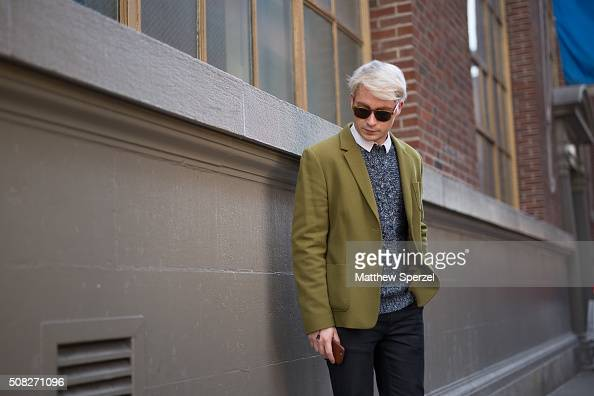 Zac Presley is seen on Spring Street wearing vintage cashmere blazer Warby Parker glasses French Connection sweater Hugo Boss shirt Nudie Jeans pants...