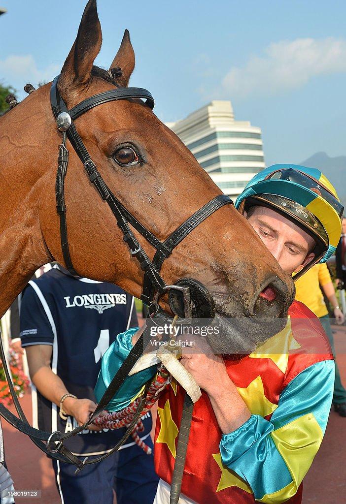 Zac Purton kissing Ambitious Dragon after winning The Longines Hong Kong Mile during the Hong Kong International Races at Sha Tin racecourse on December 9, 2012 in Hong Kong.