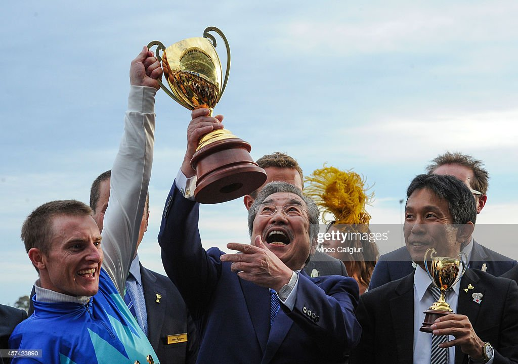 Zac Purton owner Riichi Kondo and trainer Tomoyuki Umeda pose with the trophy after Admire Rakti won Race 9 the Crown Golden Ale Caulfield Cup during...
