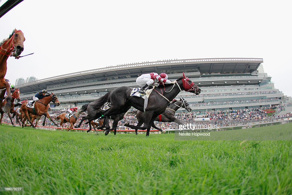 Zac Purton rides Dominant to win The Queen Mother Memorial Cup during The Champions Mile meeting at Sha Tin racecourse on May 5, 2013, in Hong Kong, Hong Kong.