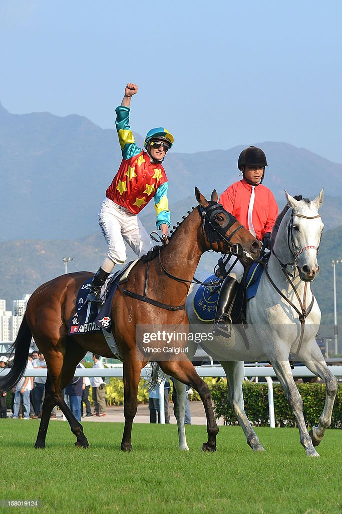 Zac Purton riding Ambitious Dragon celebrates winning The Longines Hong Kong Mile during the Hong Kong International Races at Sha Tin racecourse on December 9, 2012 in Hong Kong.