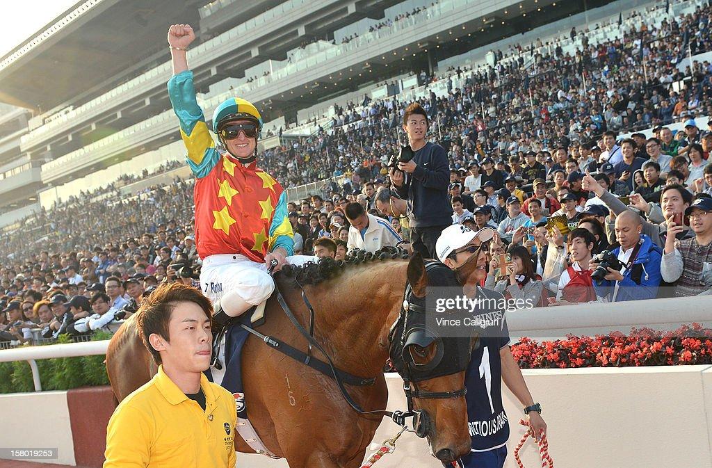 Zac Purton riding Ambitious Dragon celebrates winning The Longines Hong Kong Mile during the Hong Kong International Races at Sha Tin racecourse on December 9, 2012 in Hong Kong.