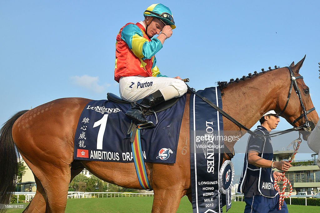 Zac Purton riding Ambitious Dragon is emotional after winning The Longines Hong Kong Mile during the Hong Kong International Races at Sha Tin racecourse on December 9, 2012 in Hong Kong.