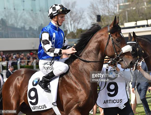 Zac Purton riding Articus in Race 8 BMW Caulfield Cup during Caulfield Cup Day at Caulfield Racecourse on October 15 2016 in Melbourne Australia