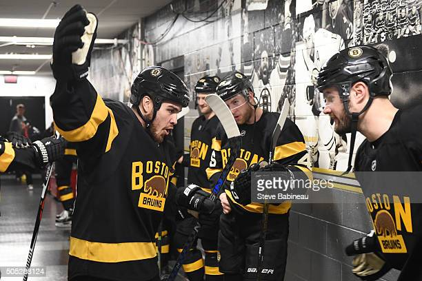 Zac Rinaldo and Tyler Randell of the Boston Bruins high five in the hallway on the way to warm ups before the game against the Toronto Maple Leafs at...