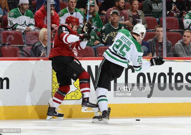 Zac Rinaldo of the Arizona Coyotes and Brett Ritchie of the Dallas Stars battle for the puck along the boards during the second period at Gila River...