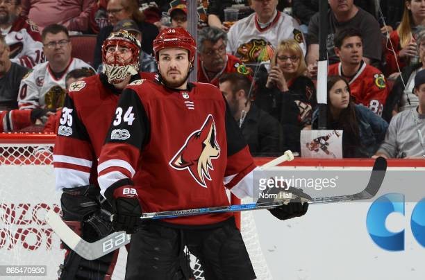 Zac Rinaldo of the Arizona Coyotes stands in front of teammate Louis Domingue while looking up ice during a stop in play against the Chicago...