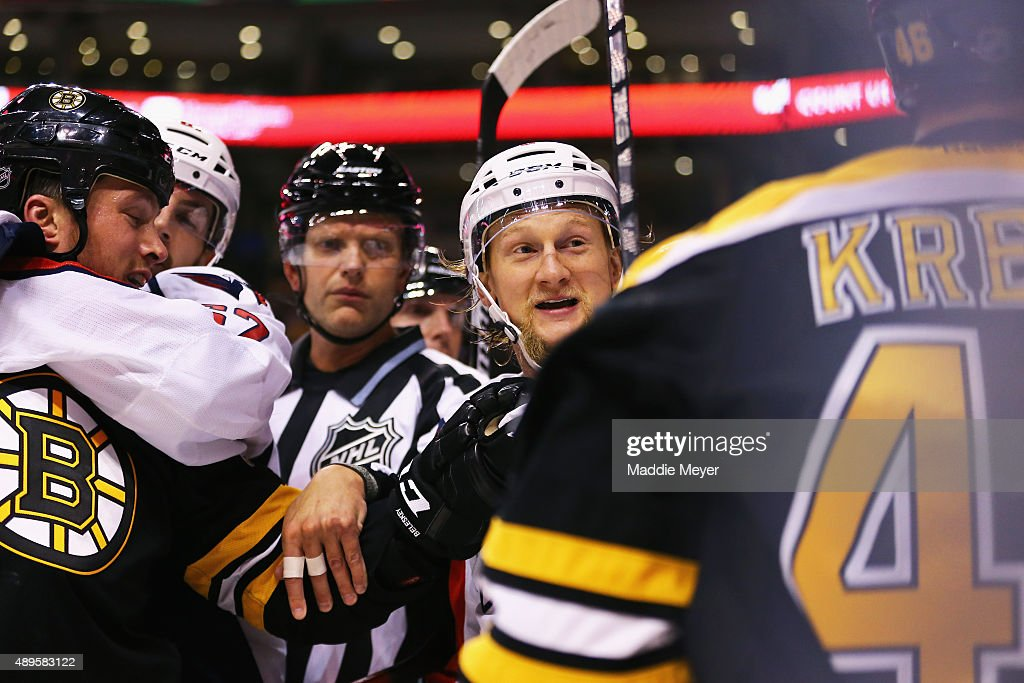Zac Rinaldo #36 of the Boston Bruins, David Krejci #46 and Tim Gleason #6 of the Washington Capitals are separated during a fight in the first period at TD Garden on September 22, 2015 in Boston, Massachusetts.