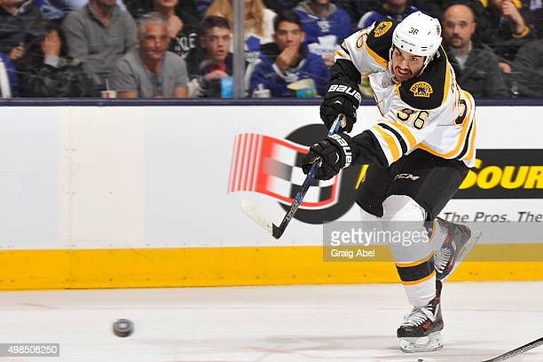 Zac Rinaldo of the Boston Bruins shoots the puck during NHL game action against the Toronto Maple Leafs November 23 2015 at Air Canada Centre in...