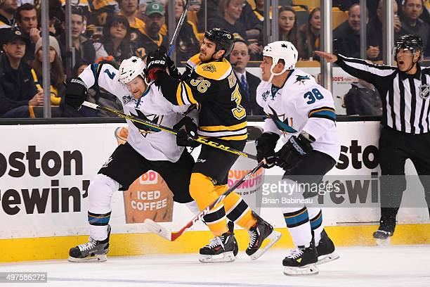 Zac Rinaldo of the Boston Bruins skates against Paul Martin and Michael Haley of the San Jose Sharks at the TD Garden on November 17 2015 in Boston...