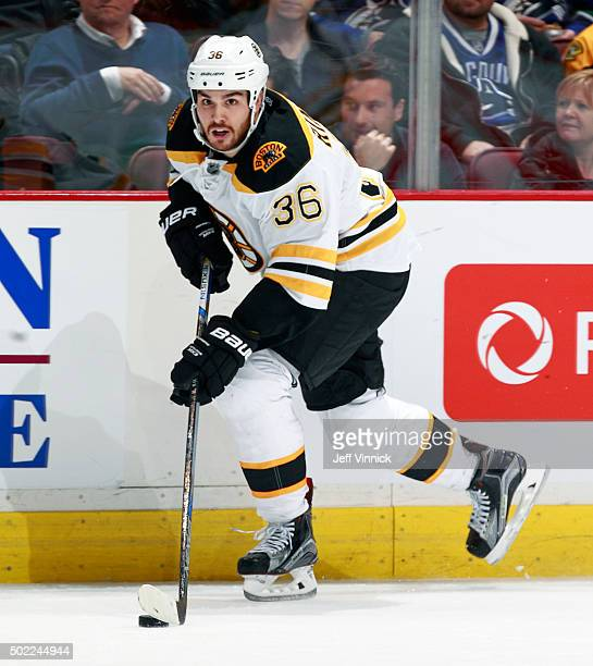 Zac Rinaldo of the Boston Bruins skates up ice with the puck during their NHL game against the Vancouver Canucks at Rogers Arena December 5 2015 in...