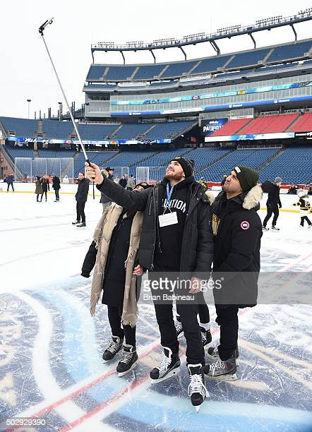 Zac Rinaldo of the Boston Bruins takes a selfie photo during the Family Skate prior to the 2016 Bridgestone NHL Winter Classic at Gillette Stadium on...