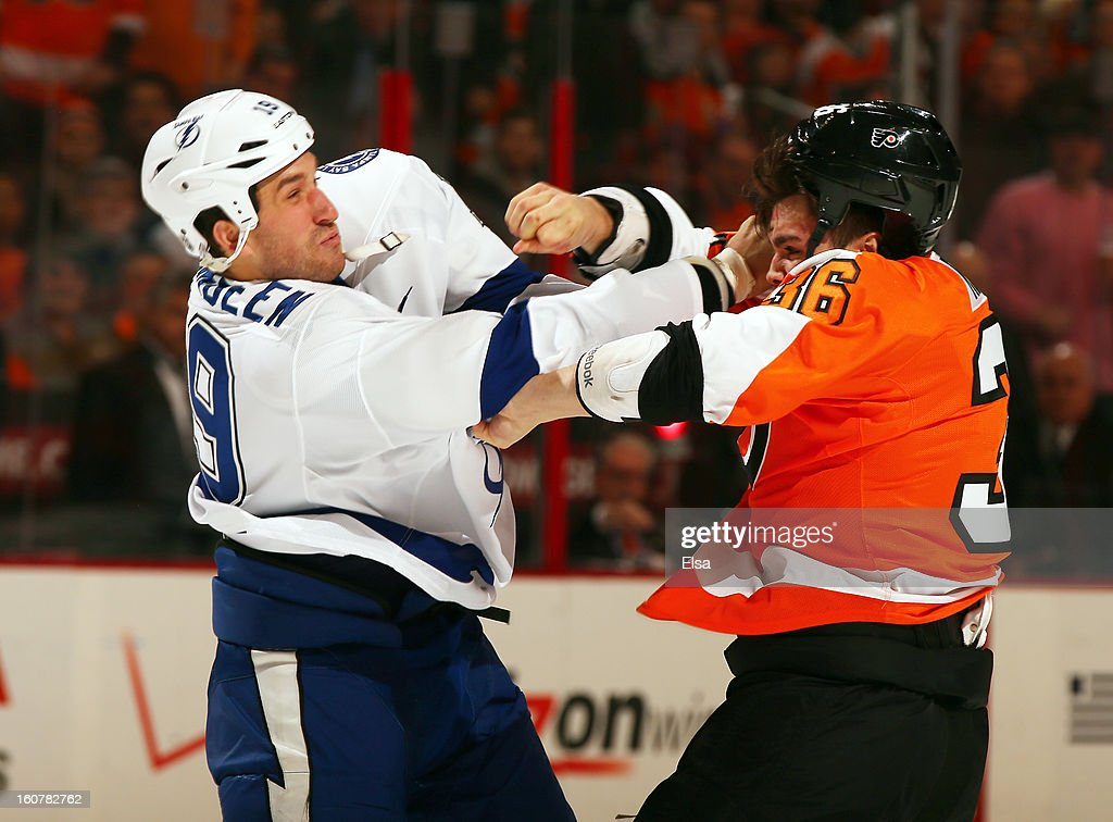 Zac Rinaldo #36 of the Philadelphia Flyers and B.J. Crombeen #19 of the Tampa Bay Lightning fight in the first period on February 5, 2013 at the Wells Fargo Center in Philadelphia, Pennsylvania.