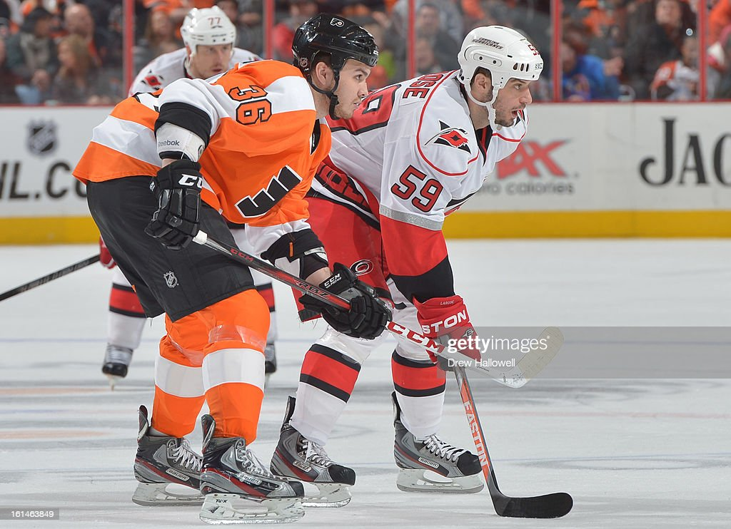 Zac Rinaldo #36 of the Philadelphia Flyers and Chad LaRose #59 of the Carolina Hurricanes get set for a face-off at the Wells Fargo Center on February 9, 2013 in Philadelphia, Pennsylvania.