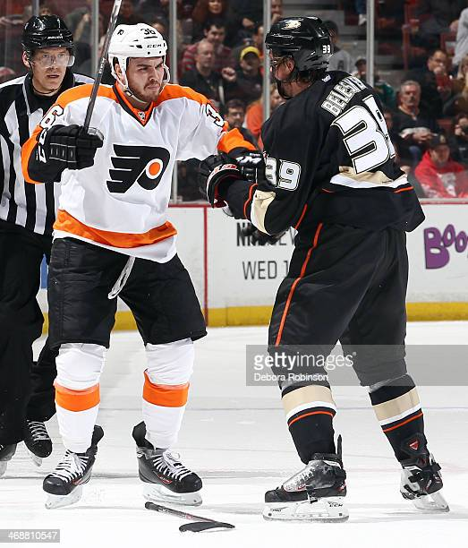 Zac Rinaldo of the Philadelphia Flyers gets ready to mix it up with Matt Beleskey of the Anaheim Ducks on January 30 2014 at Honda Center in Anaheim...