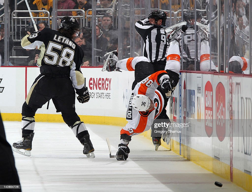 Zac Rinaldo of the Philadelphia Flyers gets up ended by Kris Letang of the Pittsburgh Penguins in Game Two of the Eastern Conference Quarterfinals...
