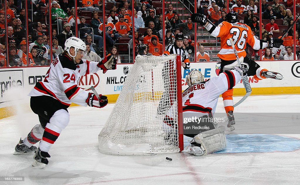 Zac Rinaldo #36 of the Philadelphia Flyers is denied a scoring chance by goaltender <a gi-track='captionPersonalityLinkClicked' href=/galleries/search?phrase=Johan+Hedberg&family=editorial&specificpeople=202078 ng-click='$event.stopPropagation()'>Johan Hedberg</a> #1 of the New Jersey Devils as <a gi-track='captionPersonalityLinkClicked' href=/galleries/search?phrase=Bryce+Salvador&family=editorial&specificpeople=208746 ng-click='$event.stopPropagation()'>Bryce Salvador</a> #24 of the Devils picks up the loose puck on March 15, 2013 at the Wells Fargo Center in Philadelphia, Pennsylvania.