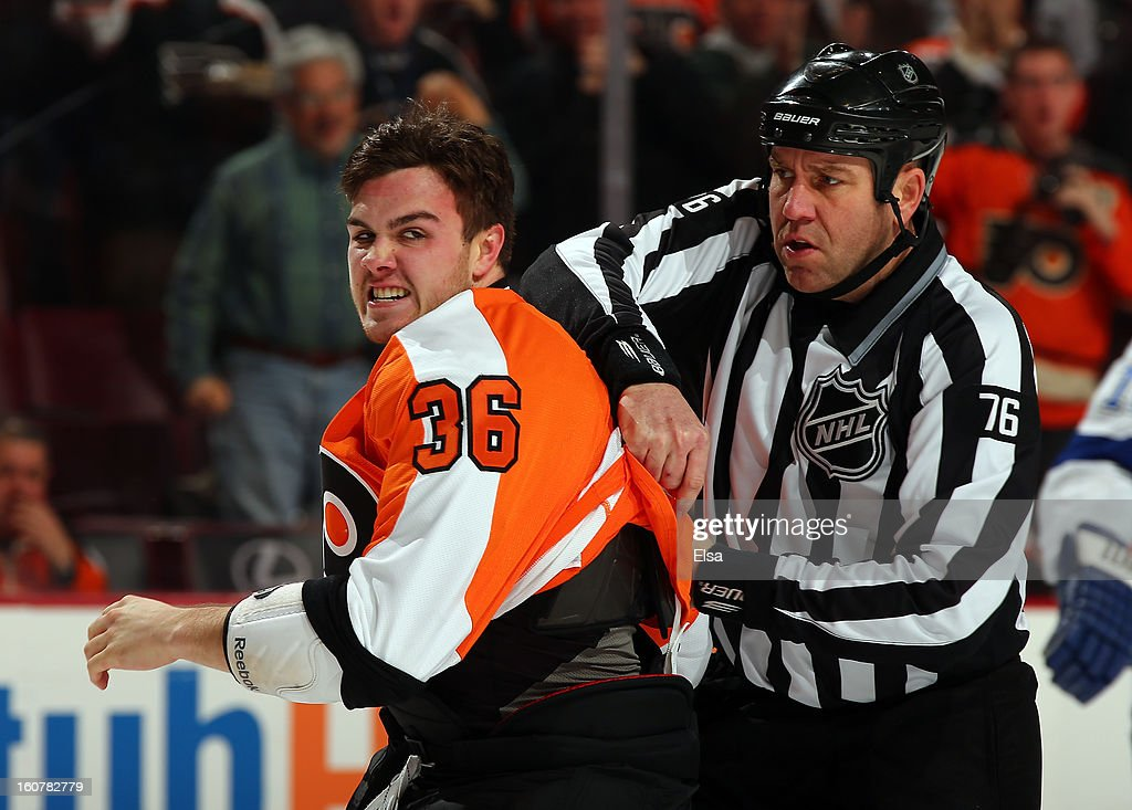 Zac Rinaldo #36 of the Philadelphia Flyers is pulled away after fighting B.J. Crombeen of the Tampa Bay Lightning in the first period on February 5, 2013 at the Wells Fargo Center in Philadelphia, Pennsylvania.