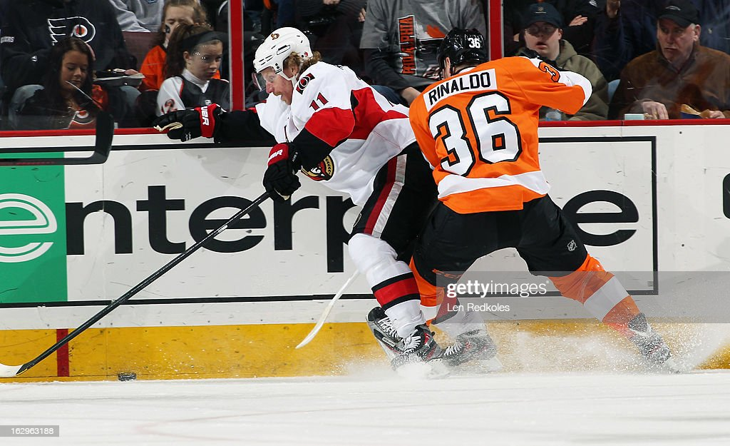 Zac Rinaldo #36 of the Philadelphia Flyers pins Daniel Alfredsson #11 of the Ottawa Senators to the boards while battling for the loose puck on March 2, 2013 at the Wells Fargo Center in Philadelphia, Pennsylvania.