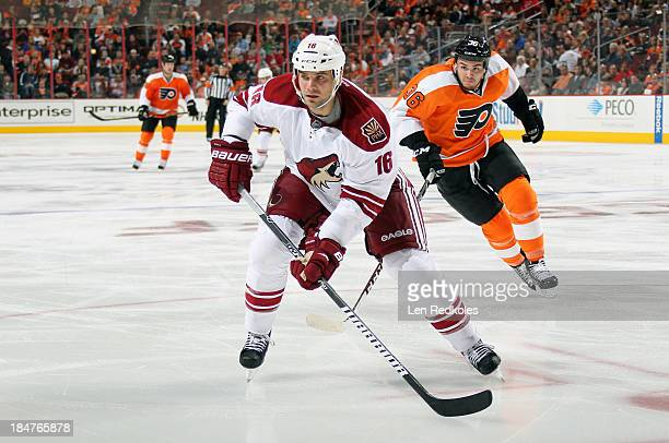Zac Rinaldo of the Philadelphia Flyers skates after Rostislav Klesla of the Phoenix Coyotes on October 11 2013 at the Wells Fargo Center in...