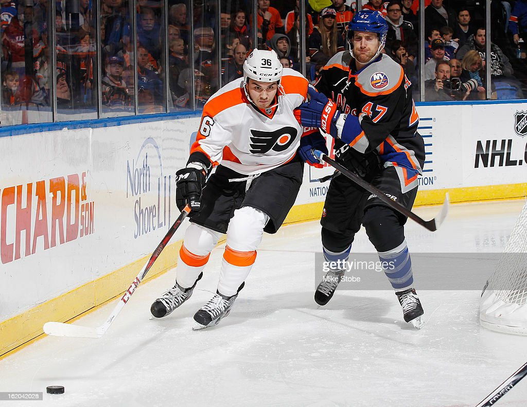 Zac Rinaldo #36 of the Philadelphia Flyers skates against Andrew MacDonald #47 of the New York Islanders at Nassau Veterans Memorial Coliseum on February 18, 2013 in Uniondale, New York.