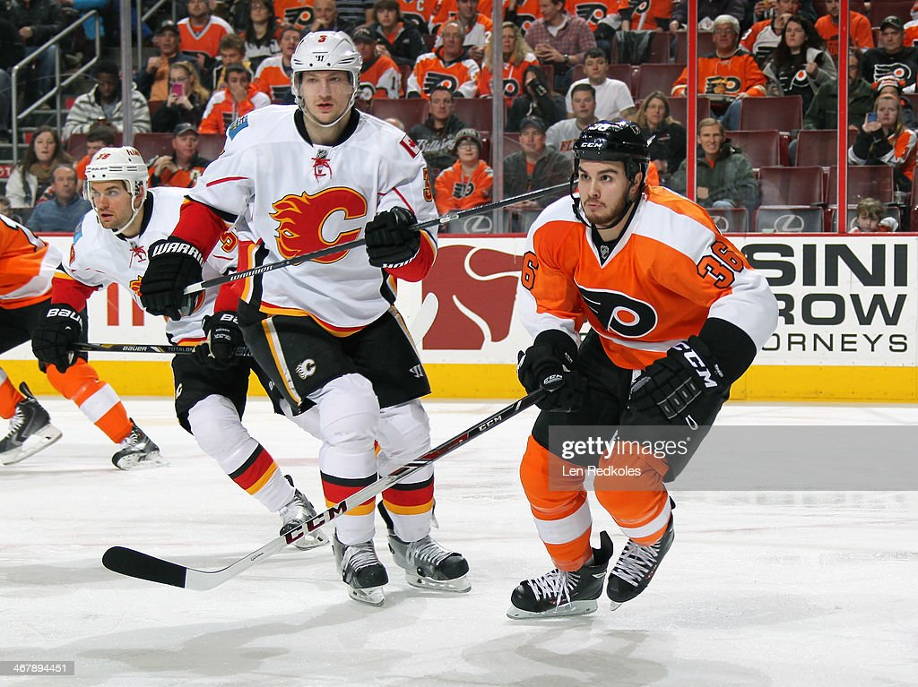 <a gi-track='captionPersonalityLinkClicked' href=/galleries/search?phrase=Zac+Rinaldo&family=editorial&specificpeople=4129574 ng-click='$event.stopPropagation()'>Zac Rinaldo</a> #36 of the Philadelphia Flyers skates against Ladislav Smid #3 of the Calgary Flames on February 8, 2014 at the Wells Fargo Center in Philadelphia, Pennsylvania.
