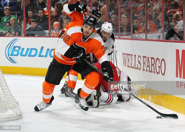 Zac Rinaldo of the Philadelphia Flyers skates the puck with teammate Carlo Colaiacovo against Corey Tropp and Alexander Wennberg of the Columbus Blue...