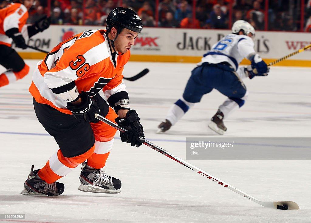 Zac Rinaldo #36 of the Philadelphia Flyers takes the puck against the Tampa Bay Lightning on February 5, 2013 at the Wells Fargo Center in Philadelphia, Pennsylvania.