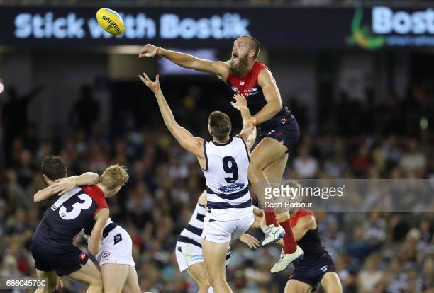 Zac Smith of the Cats and Max Gawn of the Demons compete for the ball during the round three AFL match between the Geelong Cats and the Melbourne...