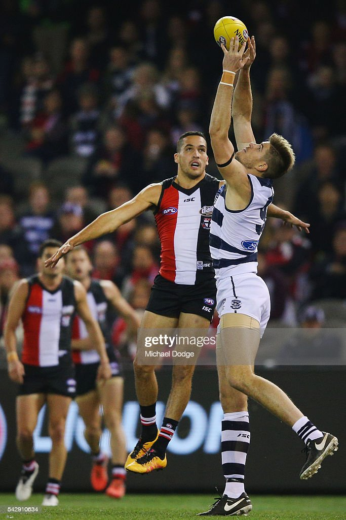 Zac Smith of the Cats marks the ball against Shane Savage of the Saints during the round 14 AFL match between the St Kilda Saints and the Geelong Cats at Etihad Stadium on June 25, 2016 in Melbourne, Australia.