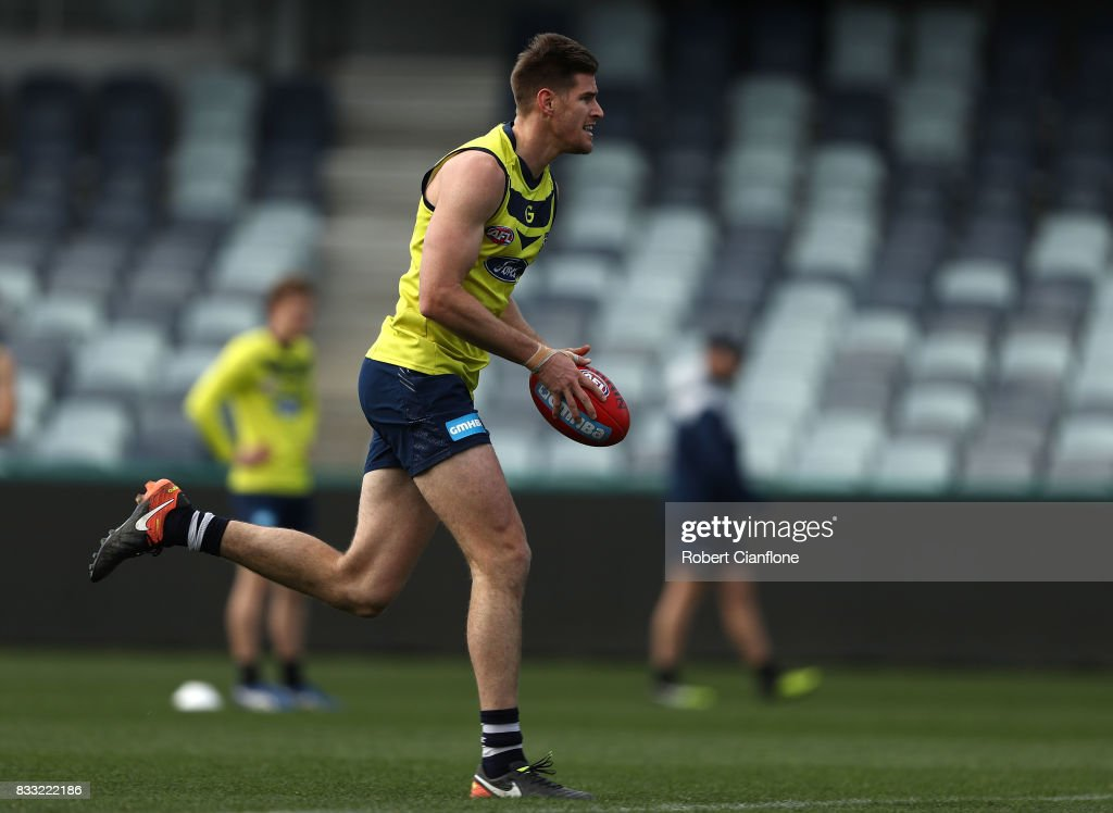 Zac Smith of the Cats runs with the ball during a Geelong Cats AFL training session at Simonds Stadium on August 17, 2017 in Geelong, Australia.