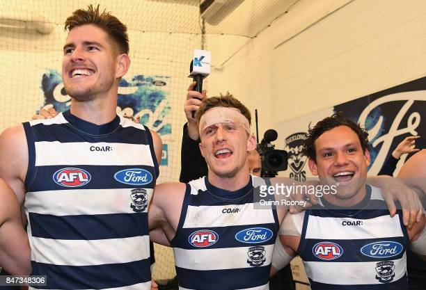 Zac Smith Scott Selwood and Steven Motlop of the Cats sing the song in the rooms after winning the Second Semi Final AFL match between the Geelong...
