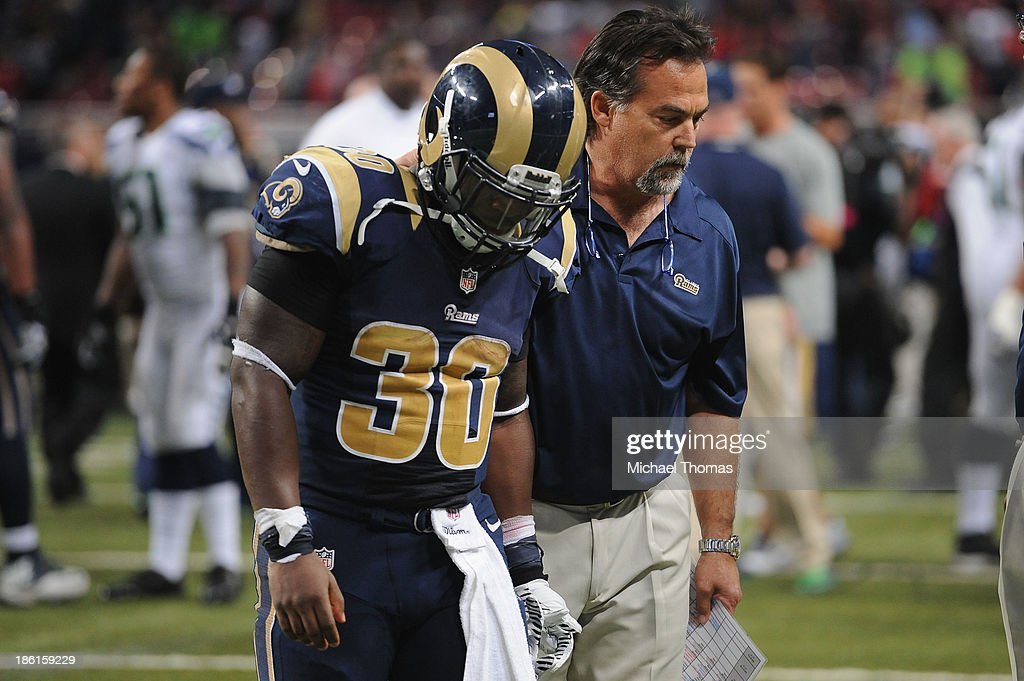<a gi-track='captionPersonalityLinkClicked' href=/galleries/search?phrase=Zac+Stacy&family=editorial&specificpeople=6513955 ng-click='$event.stopPropagation()'>Zac Stacy</a> #30 and Head Coach Jeff Fisher of the St. Louis Rams leave the field after losing to the Seattle Seahawks, 14-9 at the Edward Jones Dome on October 28, 2013 in St. Louis, Missouri.