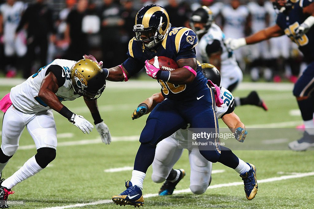 <a gi-track='captionPersonalityLinkClicked' href=/galleries/search?phrase=Zac+Stacy&family=editorial&specificpeople=6513955 ng-click='$event.stopPropagation()'>Zac Stacy</a> #30 of the St. Louis Rams rushes against the Jacksonville Jaguars at the Edward Jones Dome on October 6, 2013 in St. Louis, Missouri.
