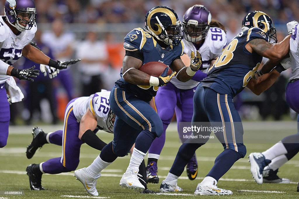 Zac Stacy #30 of the St. Louis Rams rushes against the Minnesota Vikings in the third quarter at the Edward Jones Dome on September 7, 2014 in St. Louis, Missouri. The Vikings defeated the Rams 34-6.