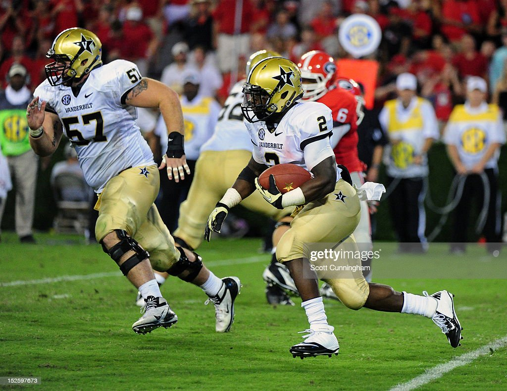 Zac Stacy #2 of the Vanderbilt Commodores carries the ball against the Georgia Bulldogs at Sanford Stadium on September 22, 2012 in Athens, Georgia.