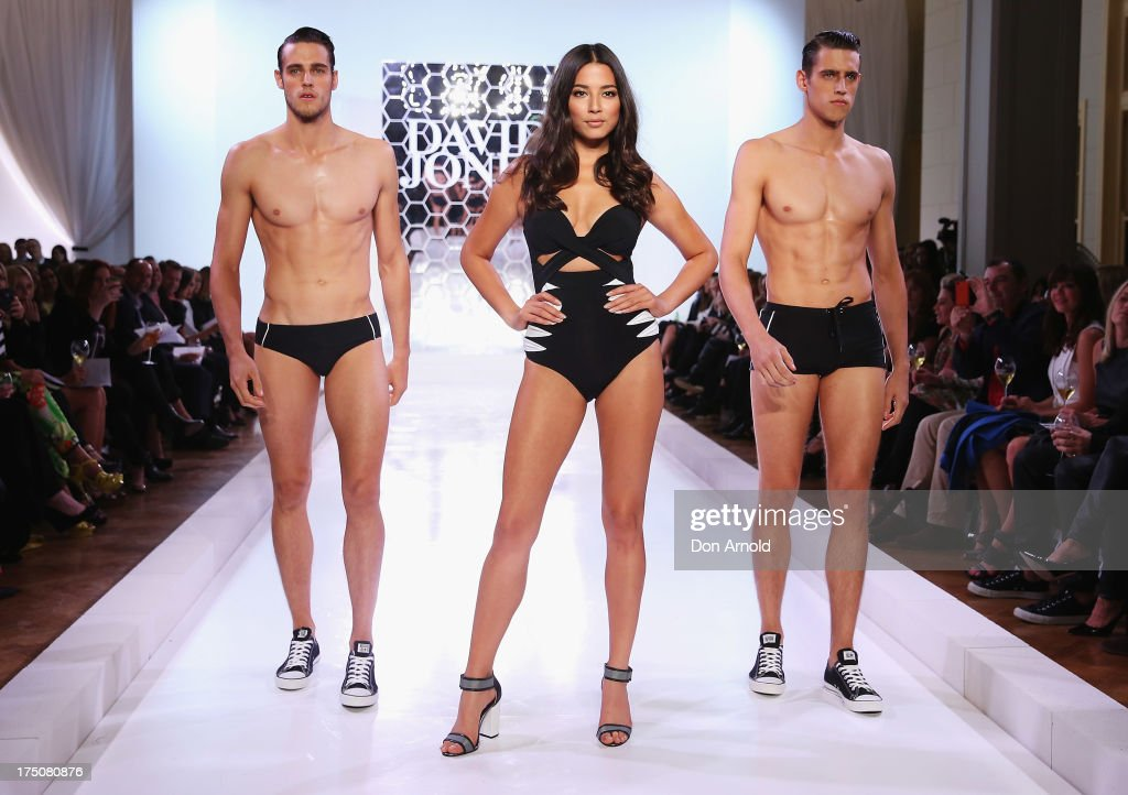 Zac Stenmark, <a gi-track='captionPersonalityLinkClicked' href=/galleries/search?phrase=Jessica+Gomes&family=editorial&specificpeople=4319063 ng-click='$event.stopPropagation()'>Jessica Gomes</a> and Jordan Stenmark showcase designs by Jets at the David Jones Spring/Summer 2013 Collection Launch at David Jones Elizabeth Street on July 31, 2013 in Sydney, Australia.