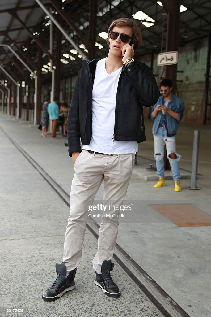 Zac Stenmark wears a Zegna jacket, Basic t-shirt, and shoes by Longmire at Mercedes-Benz Fashion Week Australia 2014 at Carriageworks on April 9, 2014 in Sydney, Australia.