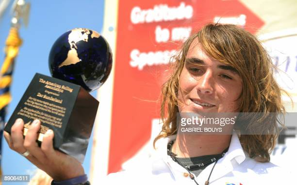 Zac Sunderland holds a trophy after he arrived at Marina Del Rey California on July 16 2009 The 17yearold teenager became the youngest person to...