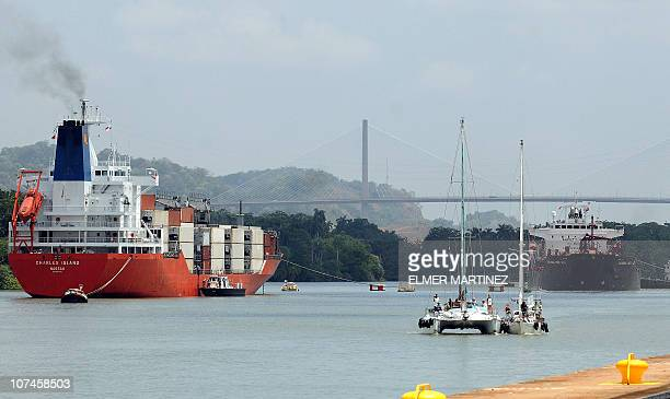 US Zac Sunderland's sailboat 'Intrepid' of crosses the Miraflores locks in the Panama Canal on May 19 2009 The Panama Canal reopened December 09 2010...