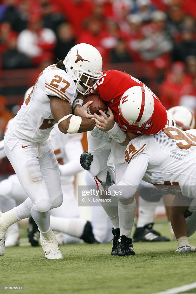 Zac Taylor of Nebraska is sacked by Michael Griffin and Thomas Marshall during action between the Texas Longhorns and Nebraska Cornhuskers on October 21, 2006 at Memorial Stadium in Lincoln, Nebraska. Texas won the game 22-20.