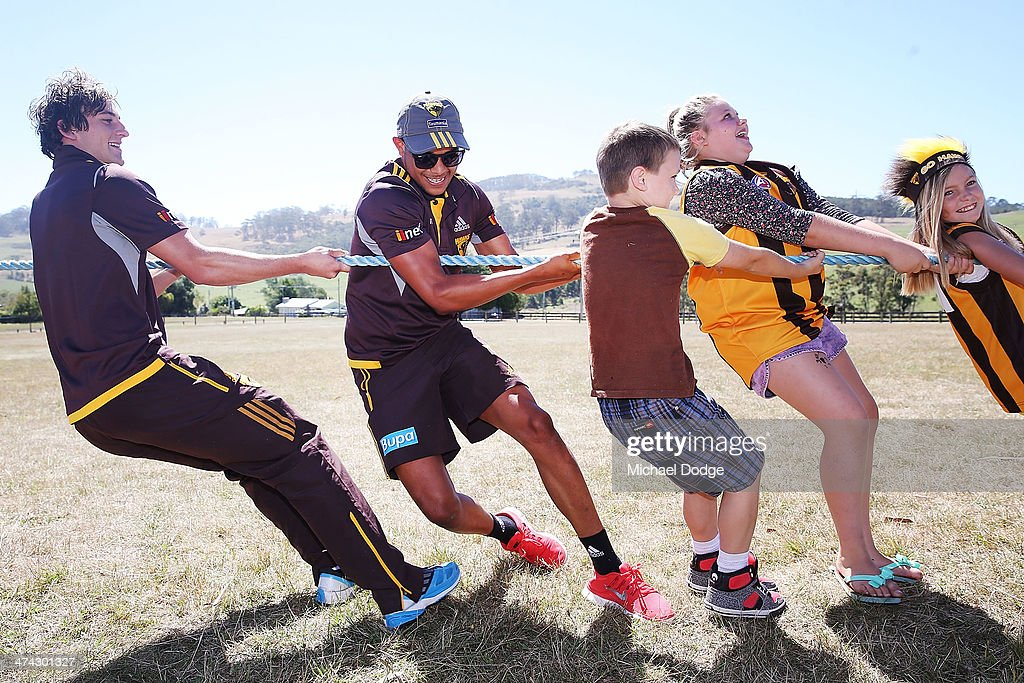 Zac Webster (L) and Dayle Garlett join kids in a Tug Of War contest at the Bream Creek Oval during the Hawthorn Hawks AFL Tasmania Community Camp on February 23, 2014 in Bream Creek, Australia.