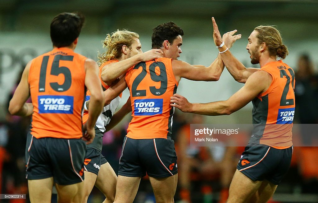Zac Williams of the Giants celebrates a goal with team mates during the round 14 AFL match between the Greater Western Sydney Giants and the Carlton Blues at Spotless Stadium on June 25, 2016 in Sydney, Australia.