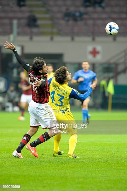 Zaccardo and Paloschi during the Serie Amatch between Milan vs Chievo Verona on March 29 2014