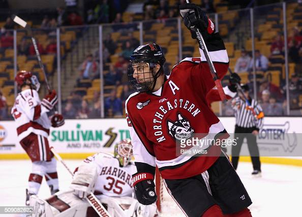Zach AstonReese of Northeastern University reacts after scoring a goal against Harvard University during the second period of the Beanpot Tournament...